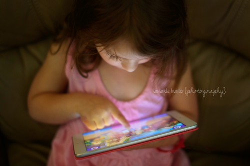Girl Playing iPad Game